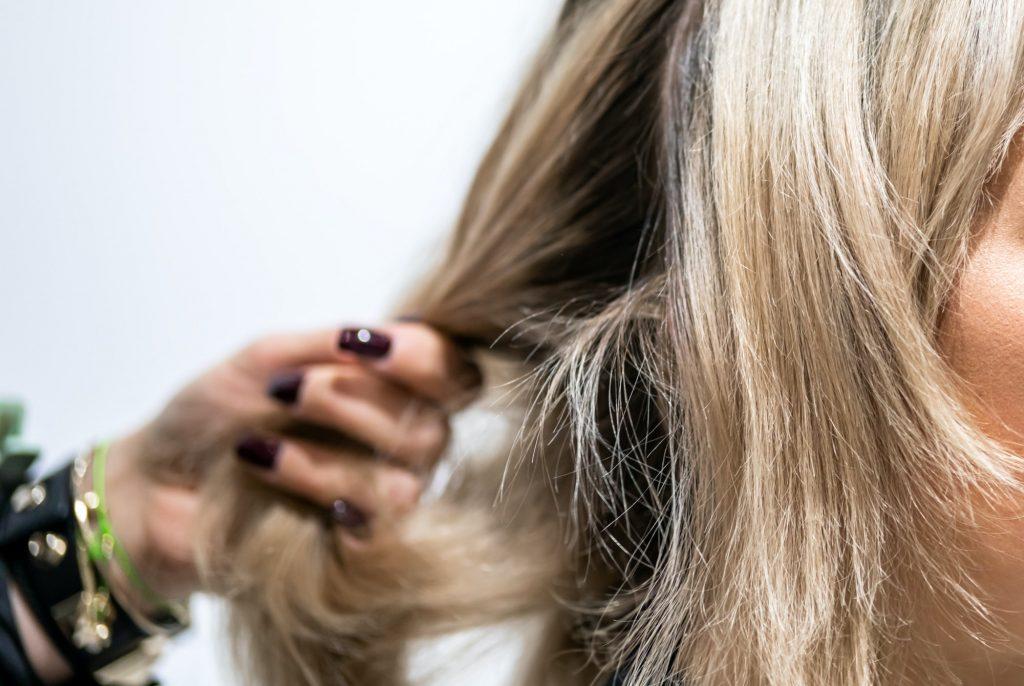 Professional hairdresser preparing client hair to haircut