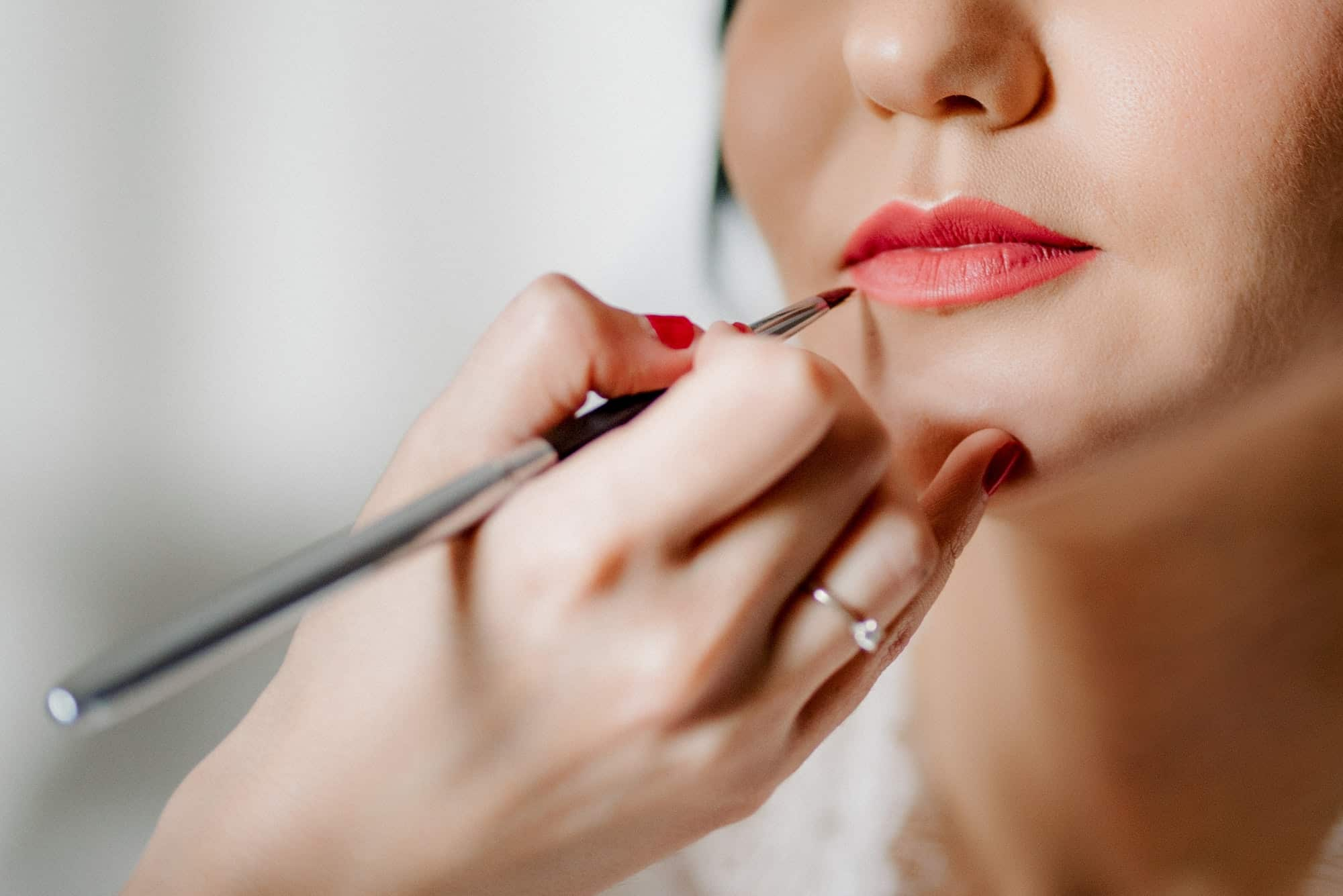 wedding makeup being applied to lips