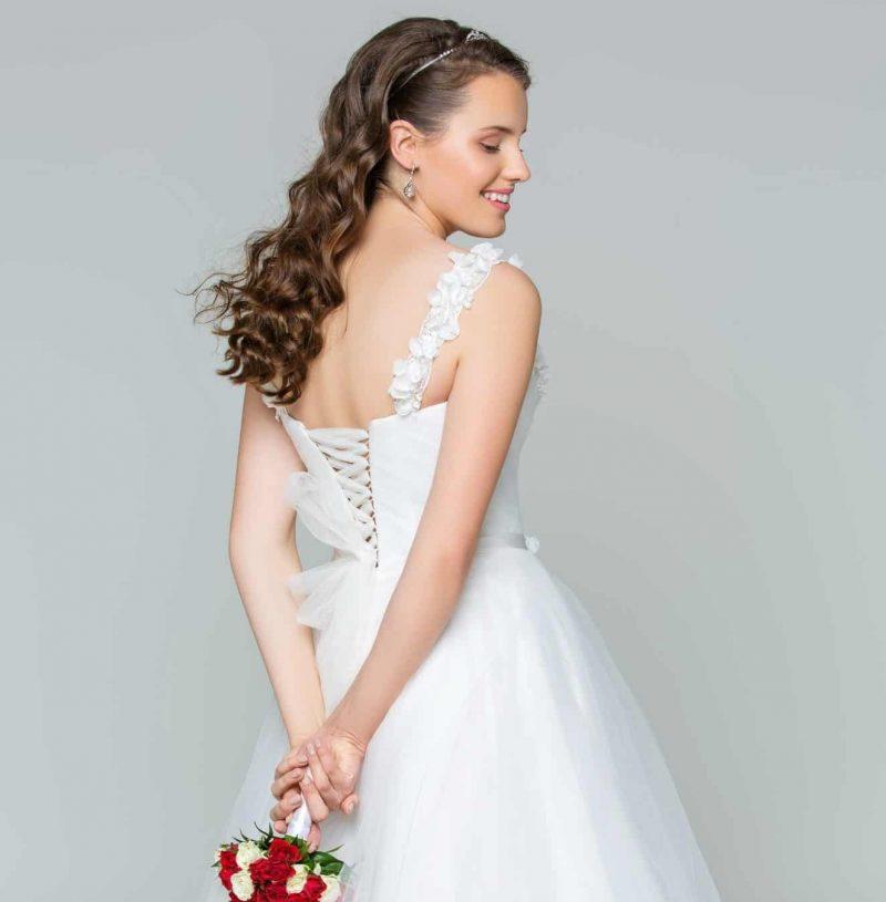 woman in wedding dress smiling