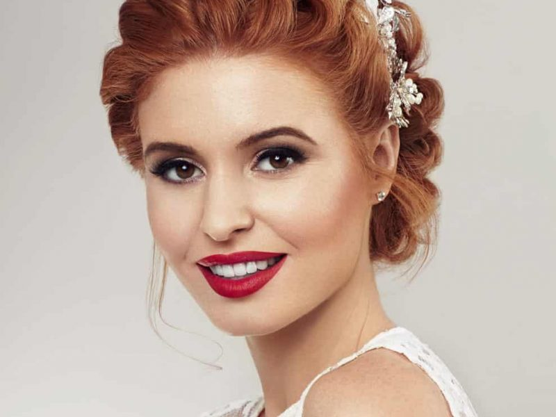 bride with red hair smiling